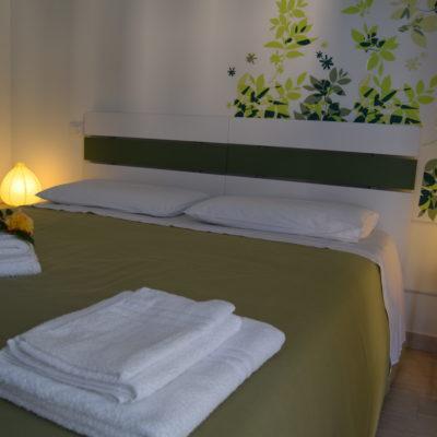 camera verde matrimoniale